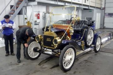 Two Museum Vehicle Inspectors inspect old 1911 Ford T-Model