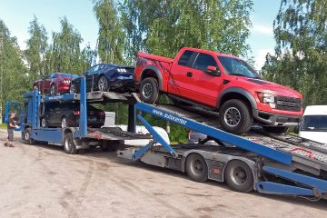 Transport truck is delivering new and used American Fords to our warehouse